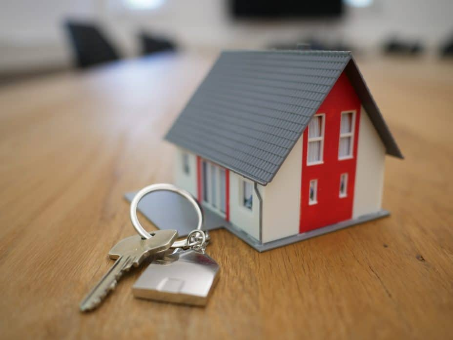 image of house keys and a small model of a house