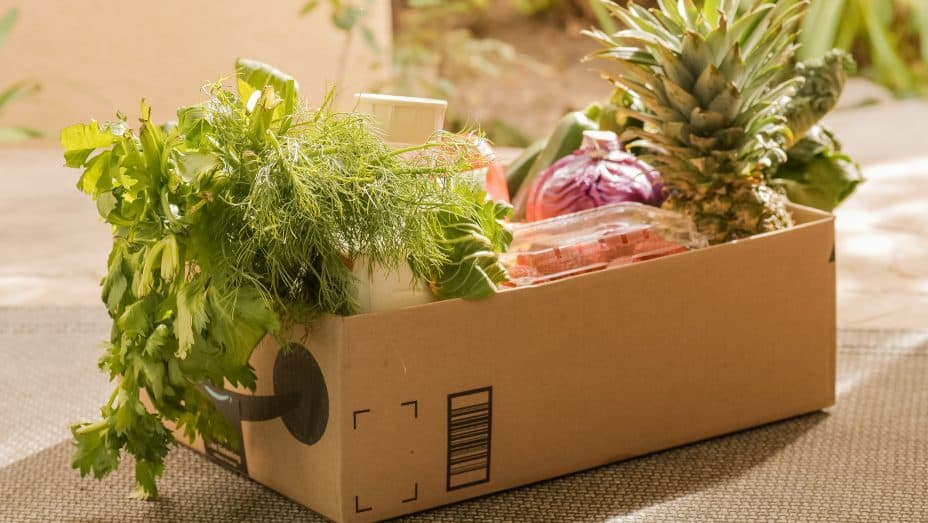 image: cardboard box full of fruits and vegetables   image to illustrate popular online business model subscription boxes